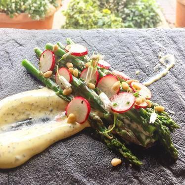 Local asparagus, lemon truffle zabaione, radish and pine nuts at Osteria