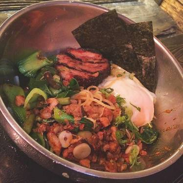 Spicy mazeman chashu with chopped bok choy and a poached egg at Ten Ramen
