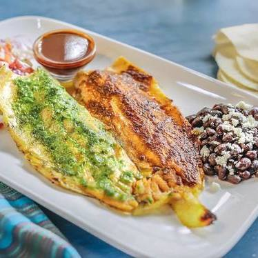 Trucha a la Parrilla (Grilled Rainbow Trout) with red and green glazed salsas and tortillas at Pacific Catch