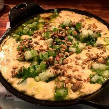 Queso fundido with chorizo verde, pico verde and melted cheese at Señor Bear