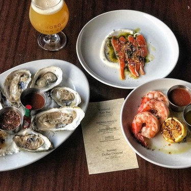 Oyster on the half shell, crudo and jumbo shrimp at Lord Hobo