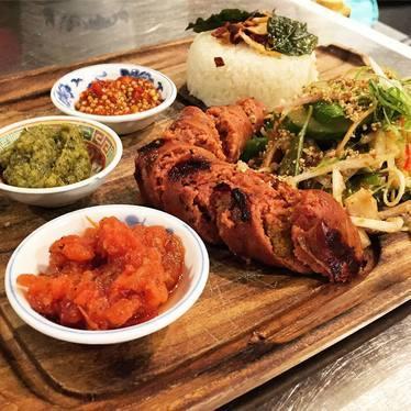 Beef and Foie Gras Rendang Sausage with nam phrik, tomato relish, garlic mustard sambal, cucumber banana blossom salad, tamarind dressing, sticky rice at DaiLo