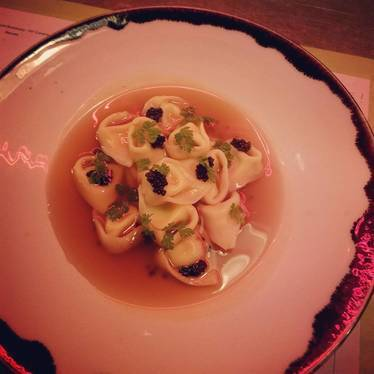 Scrambled egg tortellini in country ham Brodo at Renata