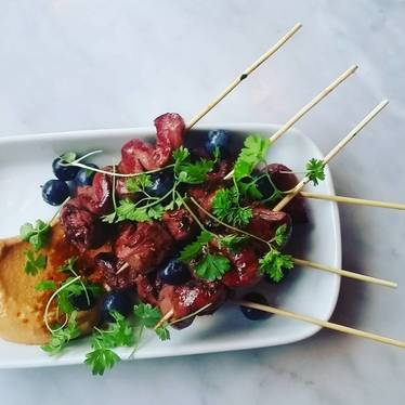 Lamb heart skewer, Romesco, Pickled blueberries, Sherry vinegar at Cooks & Soldiers