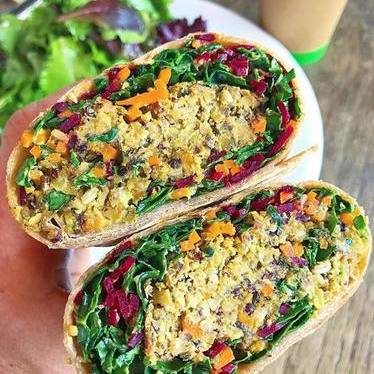 Veggie burger wrap with vegan quinoa, kale, carrots and purple cabbage at Akasha