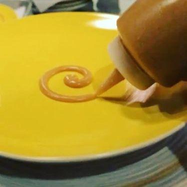 Golden raisin and aji amarillo sauce at Next