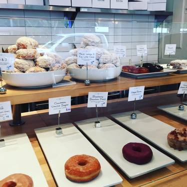 Cinnamon vanilla, blueberry bourbon basil, and maple bacon donuts at Blue Star Donuts