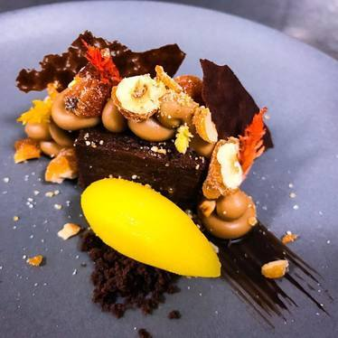 Flourless chocolate torte, hazelnut crème, mandarin clove sorbet at Luce