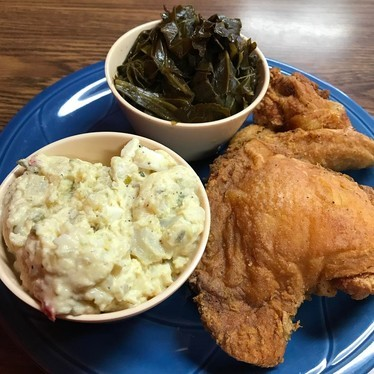 Fried chicken with mashed potatoes and collard greens at Frisco Fried