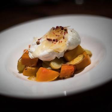 Poached eggs, butternut squash, potatoes and parmigiano at Tarallucci e Vino