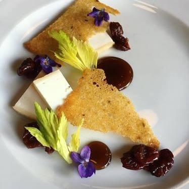Goat cheese, rye, cherries, beer jam, and celery leaves at Beast