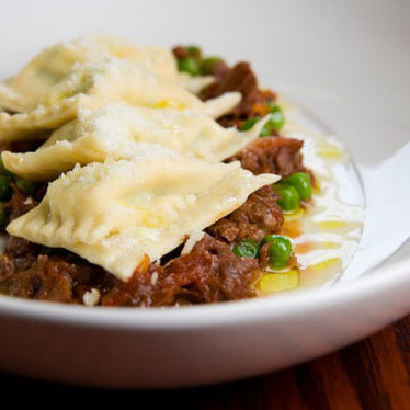Handmade ricotta, green pea and mint agnolotti with braised lamb cheeks  at La Buca