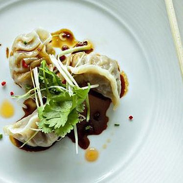 Pork belly pot stickers at Five Sixty by Wolfgang Puck