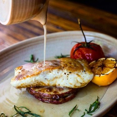"Fresh pacific halibut ""a la plancha"" with roasted new potatoes, evoo poached vine tomato, grilled meyer lemon at District Kitchen + Cocktails"