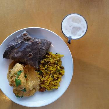 Turmeric rice, yogurt braised chicken, and flatbread  at Ma'ono Fried Chicken & Whisky