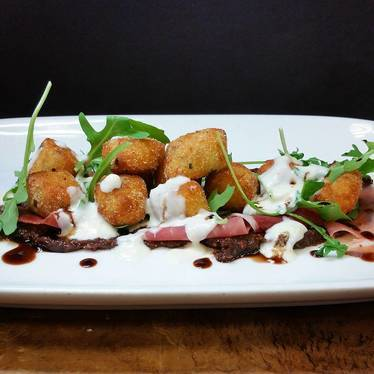 Gnocchi with prosciutto, Parmesan, fig jam, and bleu cheese at Farm Shed Dinners