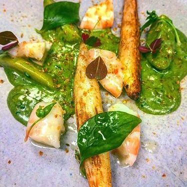 Poached and roasted white asparagus with prawns, potato and sorrel cream at Boka