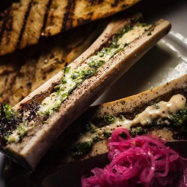 Roasted bone marrow with pickled red onions, creole remoulade, horseradish chimichurri and grilled baguette at Preux & Proper