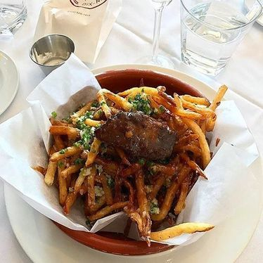 Hudson Valley Foie Gras, pomme frites, parmesan, chives, au poivre at Brasserie 19