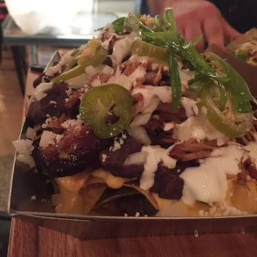 Nachos with beef, cheese, queso fresco, jalapenos at Taco Bamba