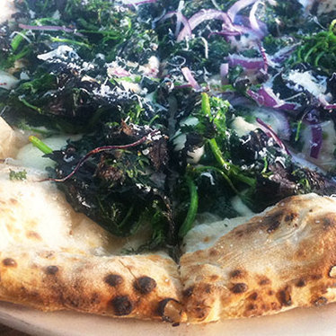 Wild nettles & pecorino pizza at Pizzaiolo