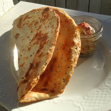 House-made naan with spread at Lenoir