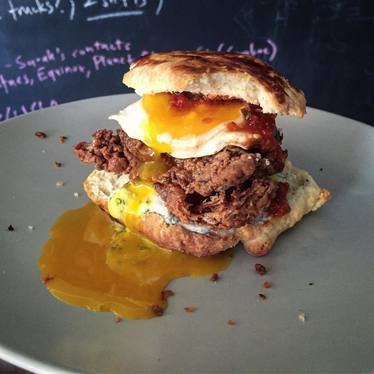 Burger with runny egg yolk at Pico House