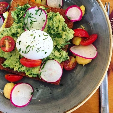Cornbread Avocado Toast with soft boiled egg and shrimp  at Lillie's Q
