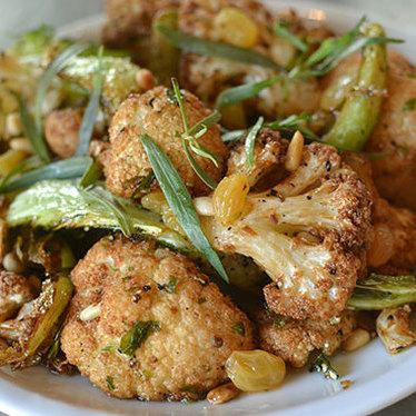 Cauliflower, pine nuts, & raisins at Coltivare Pizza & Garden