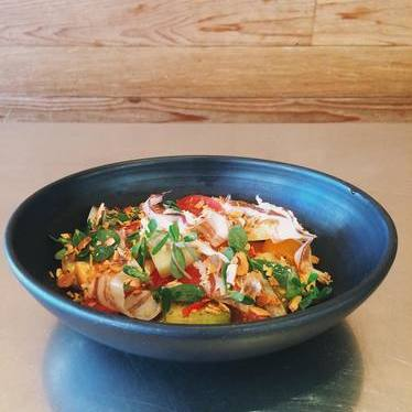 Melon and tomato salad with Calabrian chile, tessa, purslane and fennel pollen fried almonds at Avec