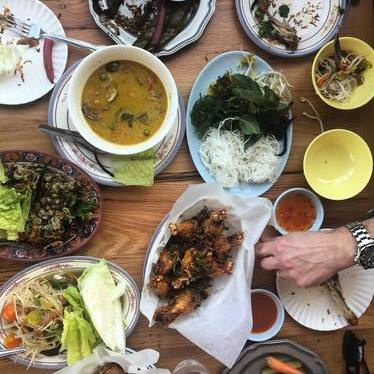Lunch spread with lettuce wraps, fried prawns and curry at