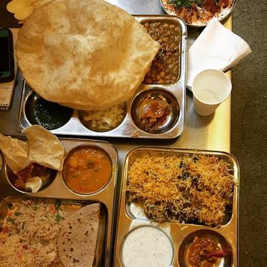 Two hour lunch feat. poori, daal, biryani, raita, tamarind and green chutney at Vik's Chaat Corner