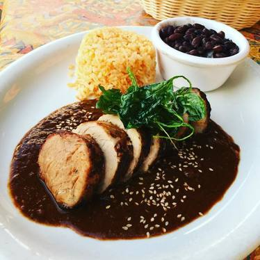 Pork loin molé, Spanish rice, black beans at Araña Taqueria Y Cantina