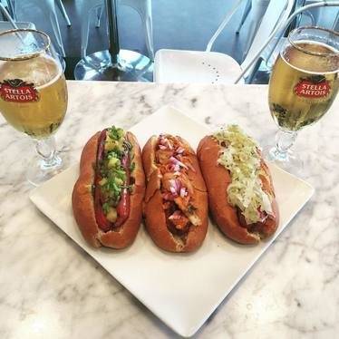 Hot dogs with sauerkraut, pickles, onions and beer at Drexel House