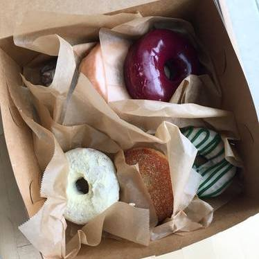 Olive oil, blueberry basil, and matcha donuts  at Blue Star Donuts