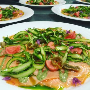 Salmon with asparagus, pickled know weed, and fermented radishes at Ruby Watch Co.