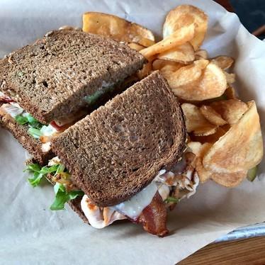Sandwich and potato chips at Moto Deli Sandwich Co.