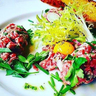 Steak tartar, condiments,  and quail egg at Brasserie Beck