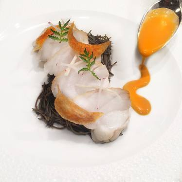 Pan roasted Monkfish w squid ink Fideos ; Spicy Chorizo Emulsion ;Elephant Garlic chips at Le Bernardin