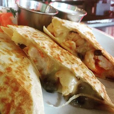 Shrimp quesadilla with peppers and cheese at Araña Taqueria Y Cantina