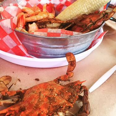 Steamed blue crabs, corn on the cob at Phillips Seafood
