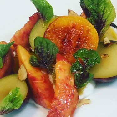 Roasted white peaches, Japanese plums, champagne vinaigrette, vegetable amaranth and shaved toasted almonds at Honey Salt