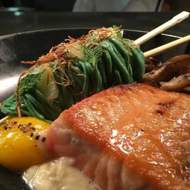 Salmon, honey soy glaze, tea pasta, 145-degree egg yolk at Fearing's