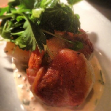 Prosciutto-wrapped shrimp with tomato aioli and lemon herb salad at Ruby Watch Co.