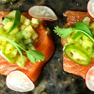 Salmon sashimi with pineapple, cucumber, pickled chiles, and passion fruit at CAVATINA at Sunset Marquis