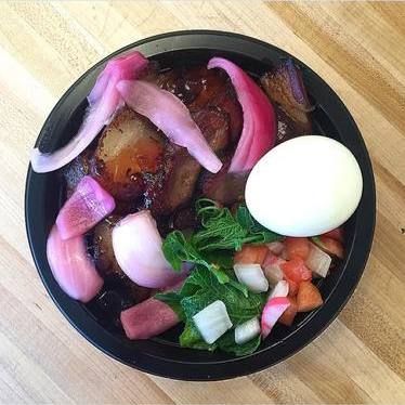 Smoked meat with guava jelly, piko onion, pipinola shoots, soft-boiled egg at Tin Roof Maui