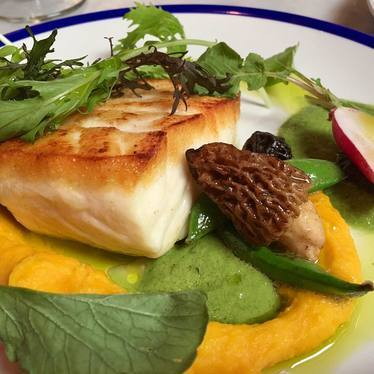 Halibut with peas, carrots and morels at Trifecta Tavern and Bakery