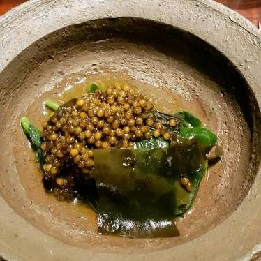 Slightly warmed caviar with seaweed and spinach at Saison