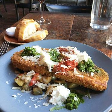 Eggplant parmesan with pepper-squash sauté, walnut pesto, goat cheese and tomato jam at Bankers Hill Bar & Restaurant
