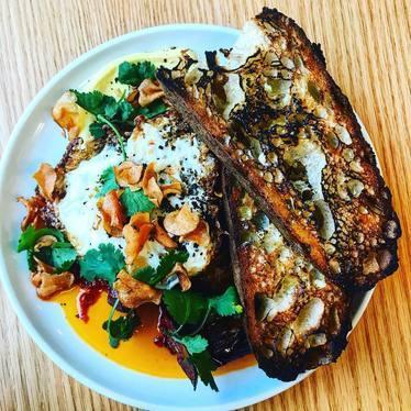 Turkish scrambled eggs with eggplant, saffron and toast at Golda Kitchen